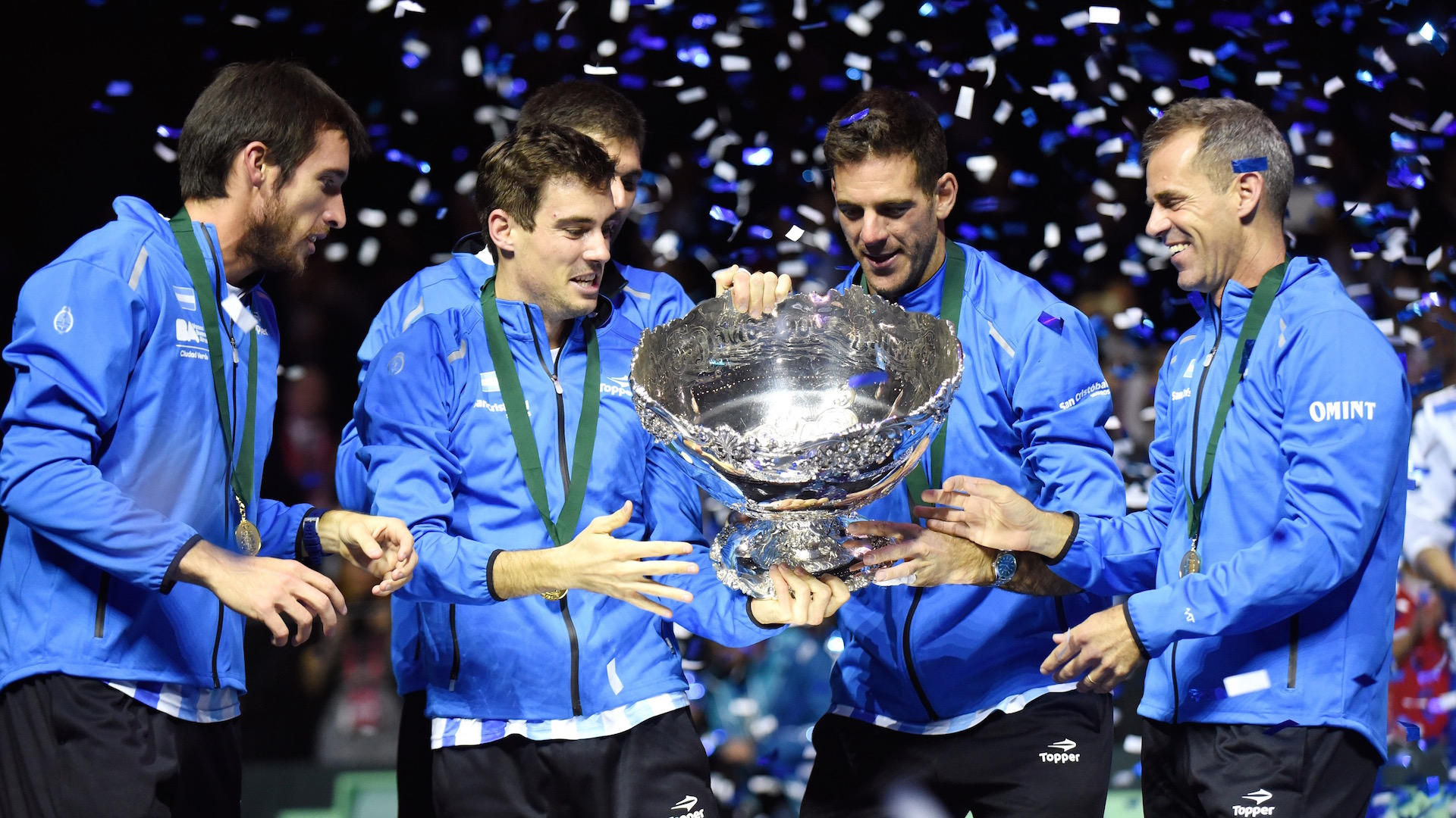 (L-R) Leonardo Mayer, Guido Pella, Federico Delbonis, Juan martin del Potro and coach coach Daniel Orsanic celebrate with the trophy after winning the Davis Cup World Group final between Croatia and Argentina on November 27, 2016 at the Arena hall in Zagreb. / AFP / - (Photo credit should read -/AFP/Getty Images)
